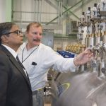 Chairman of the Indian Atomic Energy Commission and Secretary to the Government of India, Department of Atomic Energy Sekhar Basu discusses cryogenics with Fermilab engineer Rich Stanek