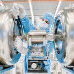 A technician works on a 325-MHz spoke resonator cavity